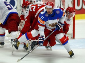 Russia's Kovalchuk fights for the puck with Denmark's Kristensen during their ice hockey World Championship game in Ostrava